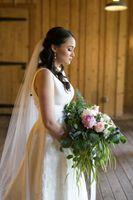 Bride looking at her bouquet portrait