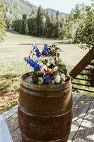 Whiskey Barrel Wedding aisle flowers