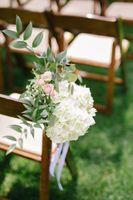 Wedding chair aisle flowers