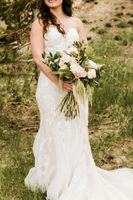 Close up Photo of Bride with her Bouquet