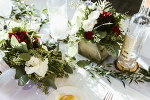 Head table flower centerpiece with bride bouquet