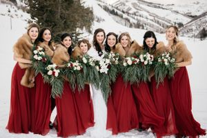 Bride on snow in mountain with bridesmaids