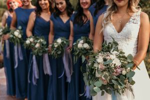 Bride and Bridesmaids in line with bouquets