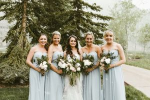 Dusty Blue Bridesmaid Dressed with Bouquets and Bride