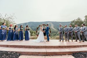 Wedding ceremony with mountain backdrop and circle arch