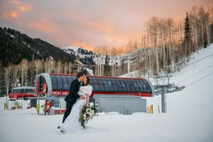 Ski lift with sunset and bride and groom