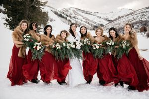 Bride and Bridesmaids standing in snow