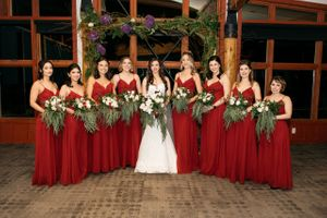Ceremony arch with bride and bridesmaids