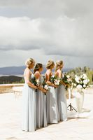Bridesmaids in line during wedding ceremony with bouquets