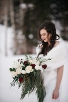 Bride staring at her bouquet in winter