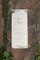 Wedding invitations on ground with moss
