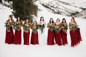 Bride and bridesmaids snowy mountain range