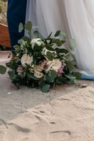 Ceremony ground with sand and bouquet