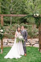 Bride and Groom photo by flower arch
