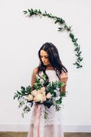 Bride with Dark Green and White Floral Bouquet
