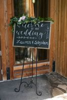 Welcome sign with garland flowers
