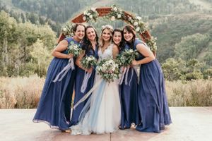 Bride with Bridesmaids wearing Dusty Blue