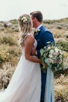Bridal photo showing bouquet and mountain background