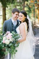 Bride and groom smile portrait with bouquet