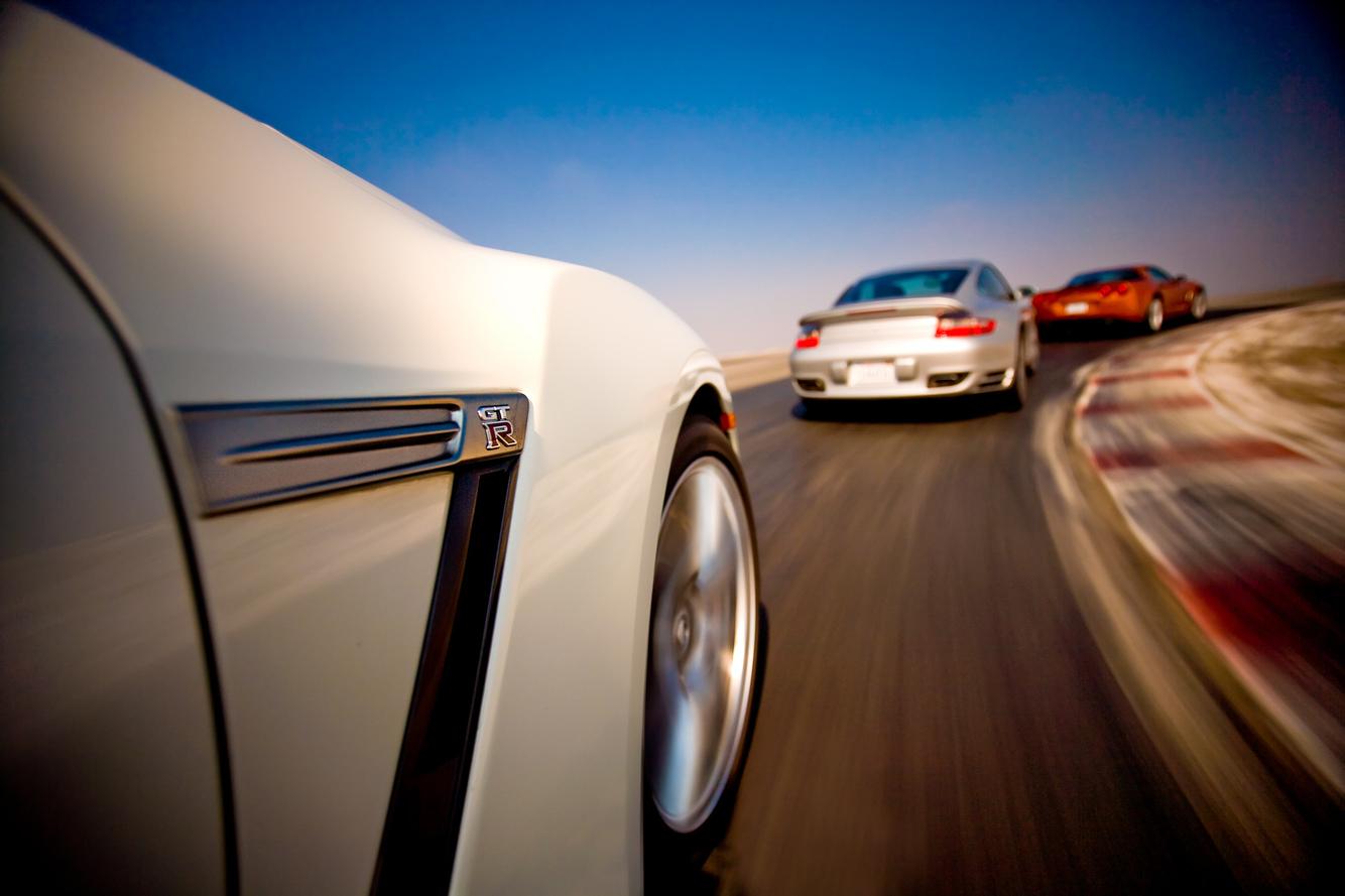 Nissan GTRchasing Porsche and Corvette around Buttonwillow