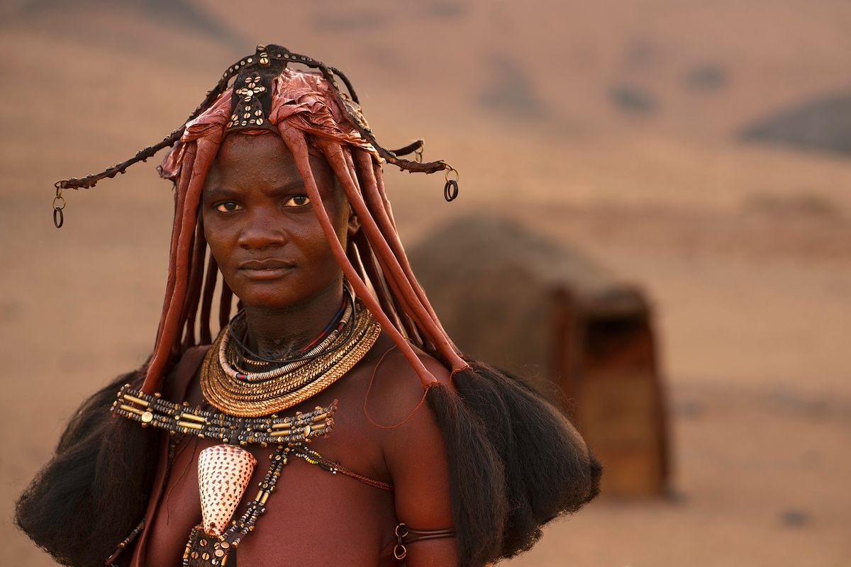 Himba Woman in front of Hut