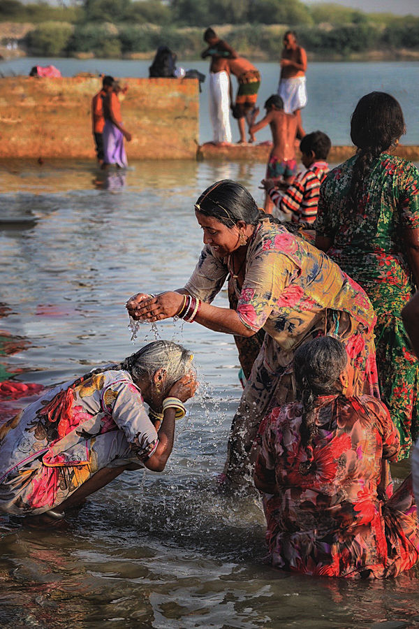 Women washing in holy river