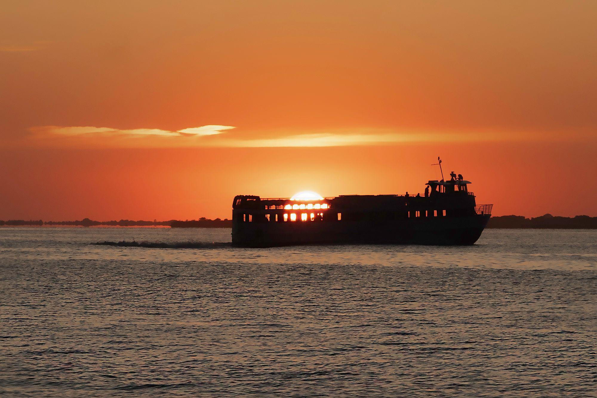 FI Ferry Swallows Sun