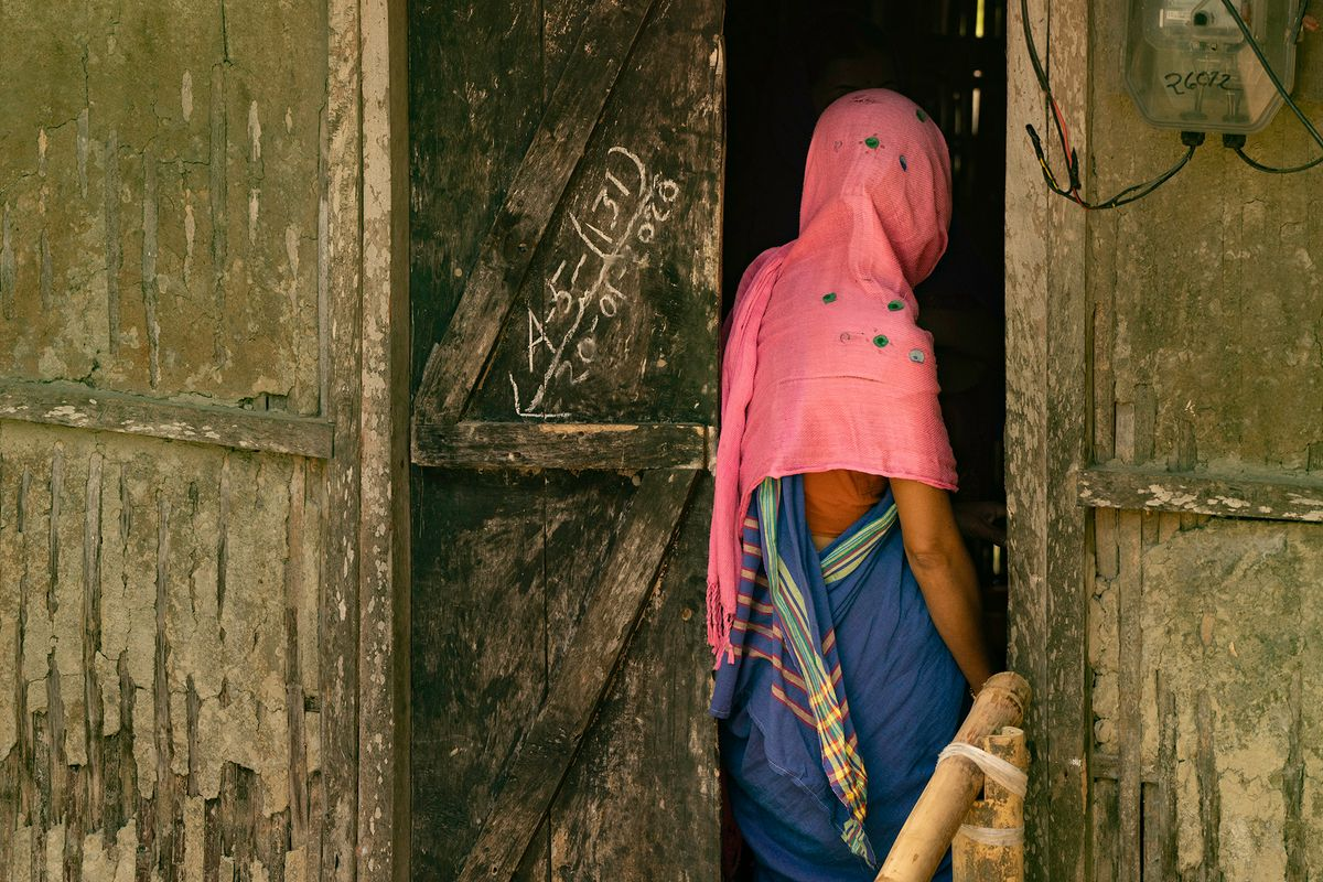 Woman entering her home