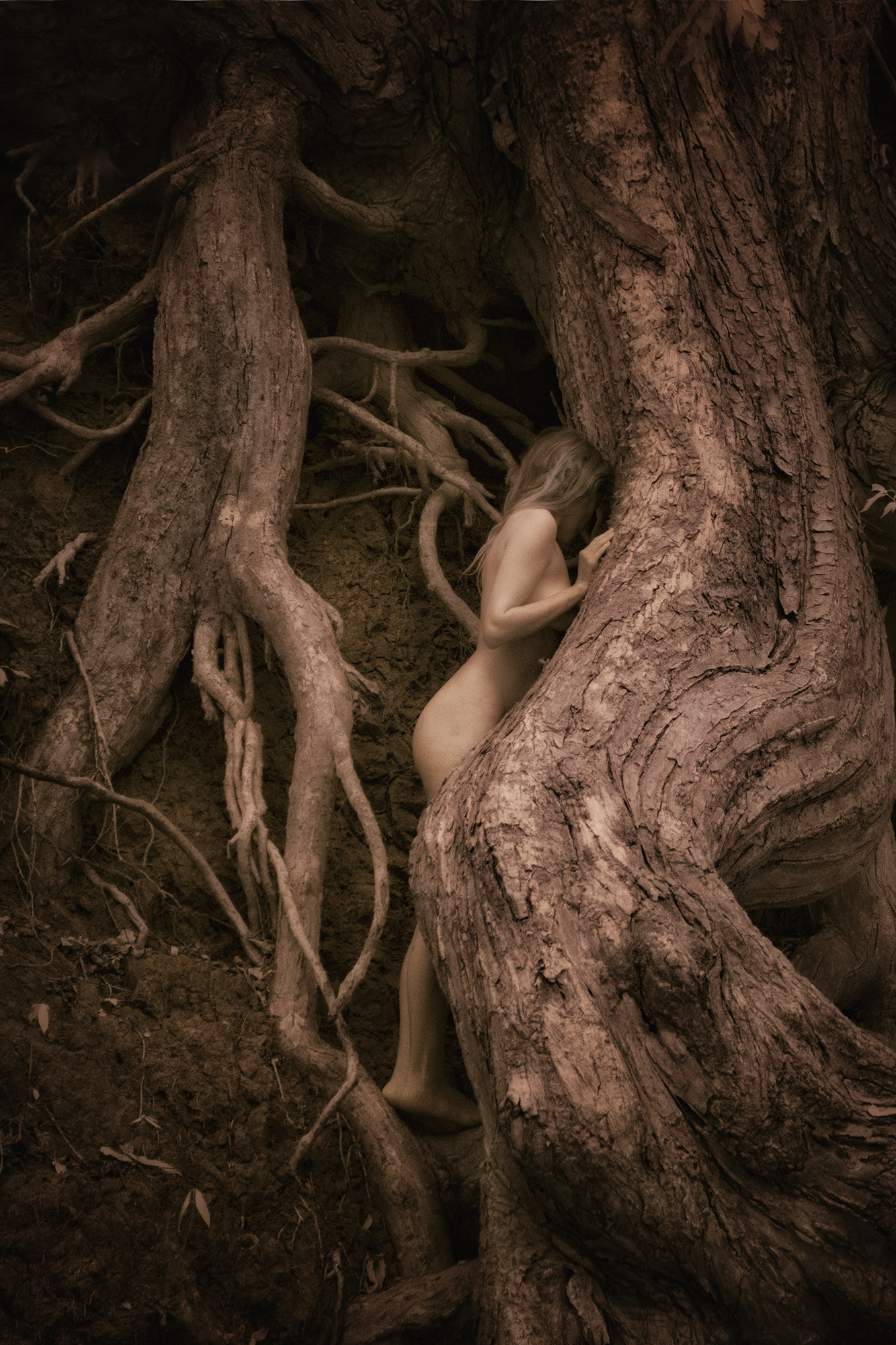 standing nude among the roots