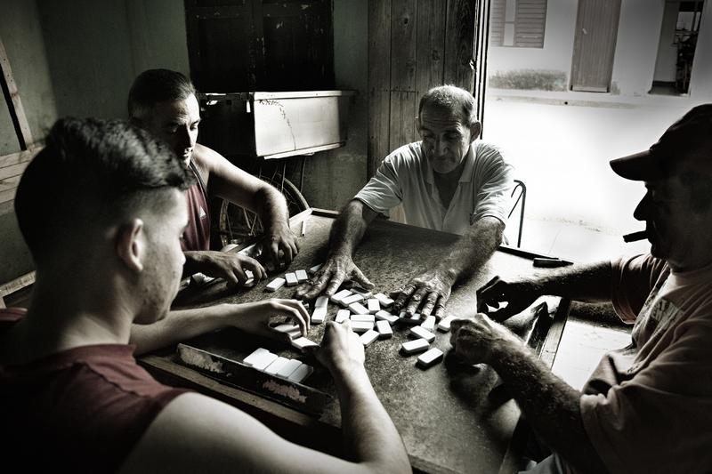 Cuban men playing Dominoes