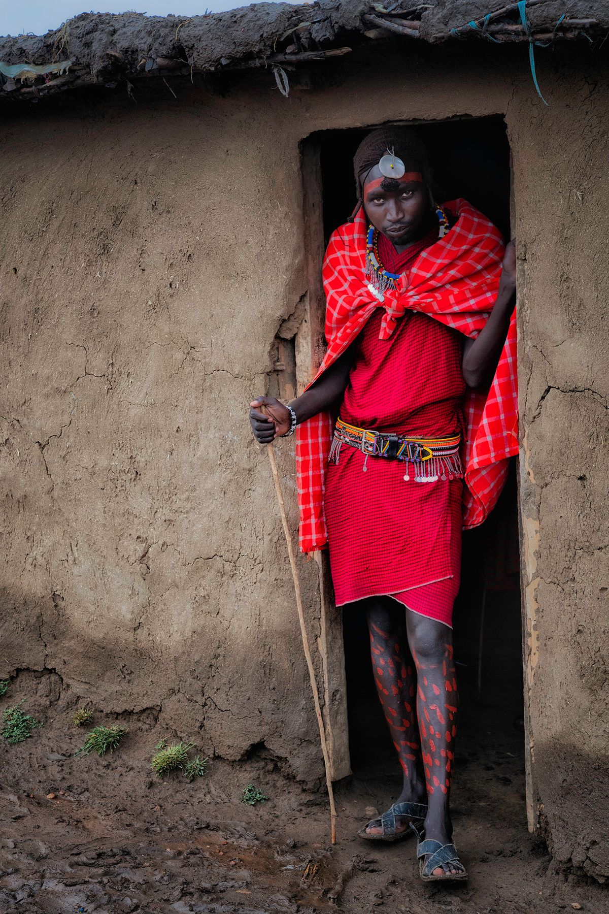 Masai man with painted legs