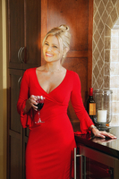 Woman with wine in a red dress