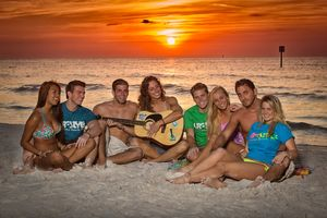 Young adults on beach at sunset