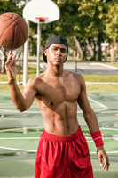 Basketball player spinning the ball on finger