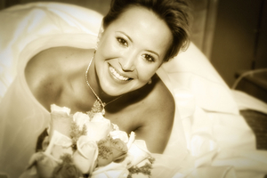 Black & White photograph Bride on bed with flowers