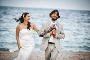 Groom with Flowers Beach Wedding