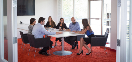 Corporate associates meeting in a conference room