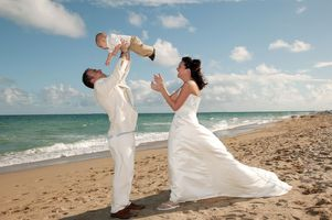 Bride and Groom on beach with Baby Boy