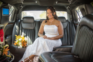 Bride in a  limo with flowers