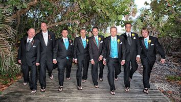 Groom and wedding party arriving in flip flops and tuxedos