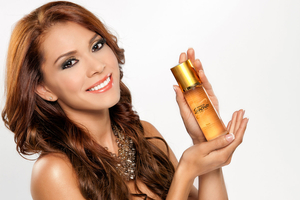 Model holding beauty product