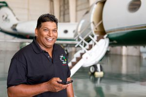 Mechanic servicing a corporate jet