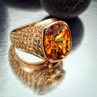 Gold and onyx ring