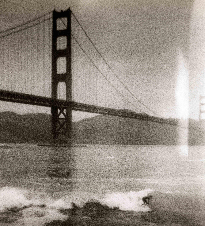 Surfer inside Golden Gate Bridge