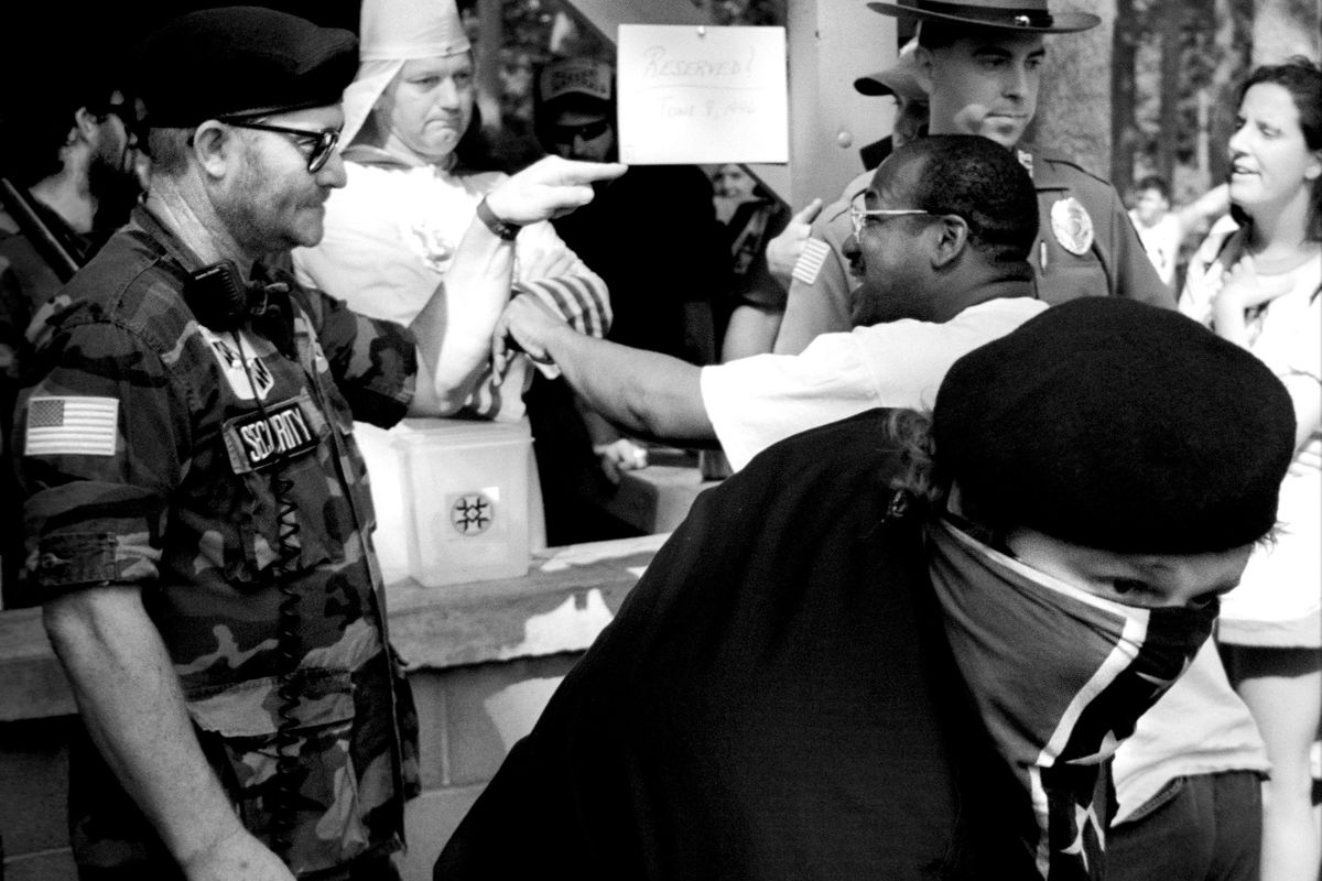 An argument between Klan members and protestors at a Invincible Knights of the Ku Klux Klan public rally. Thurmont, Maryland 1996
