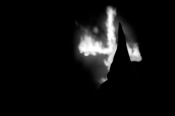 Aryan Nations Knights of the Ku Klux Klan cross lighting ceremony. Colt, Arkansas 2003