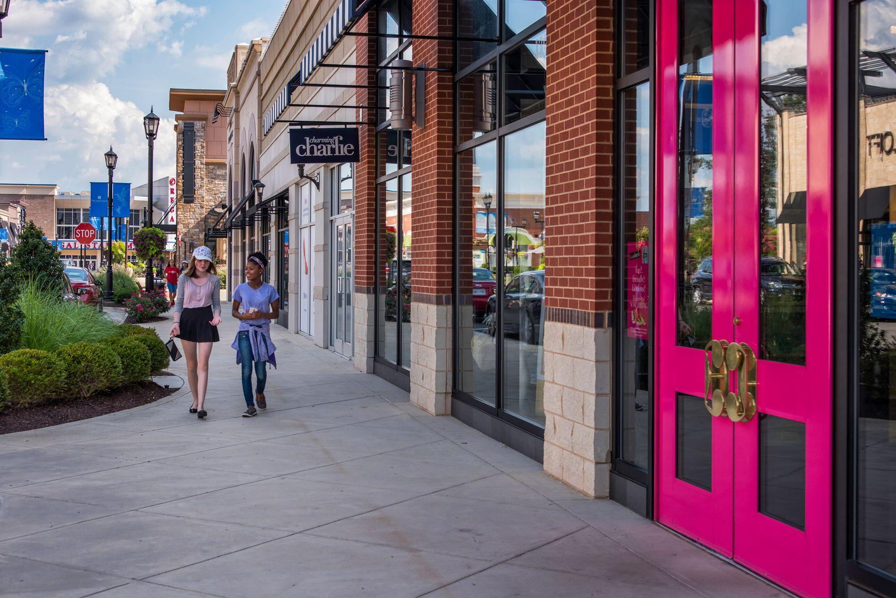 Teenage girls walking and shopping