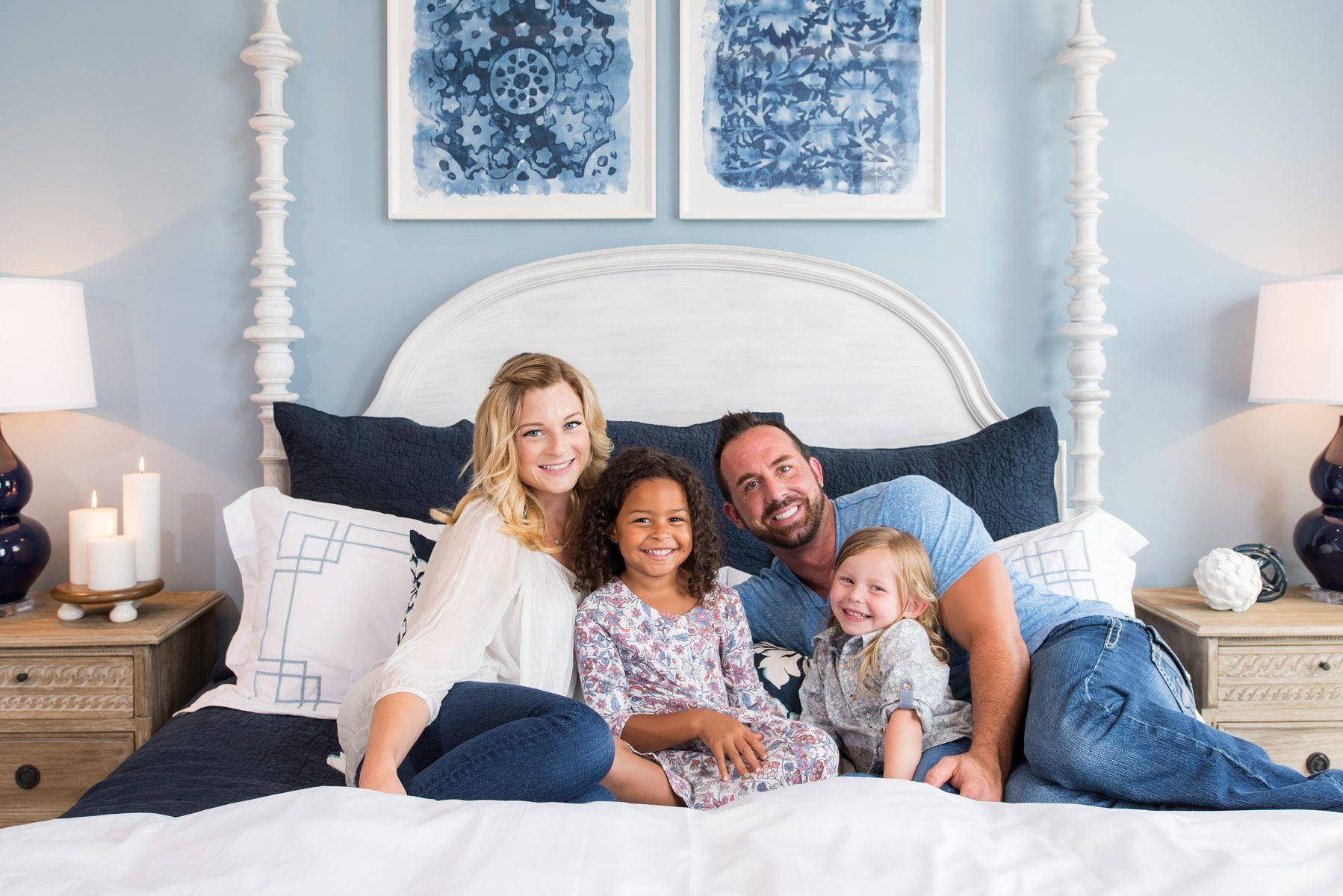 Family portrait in bedroom