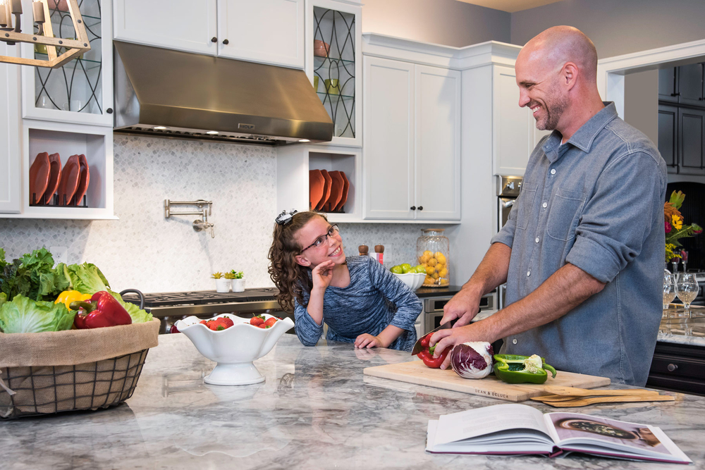 Dad and daughter cooking in kitchen