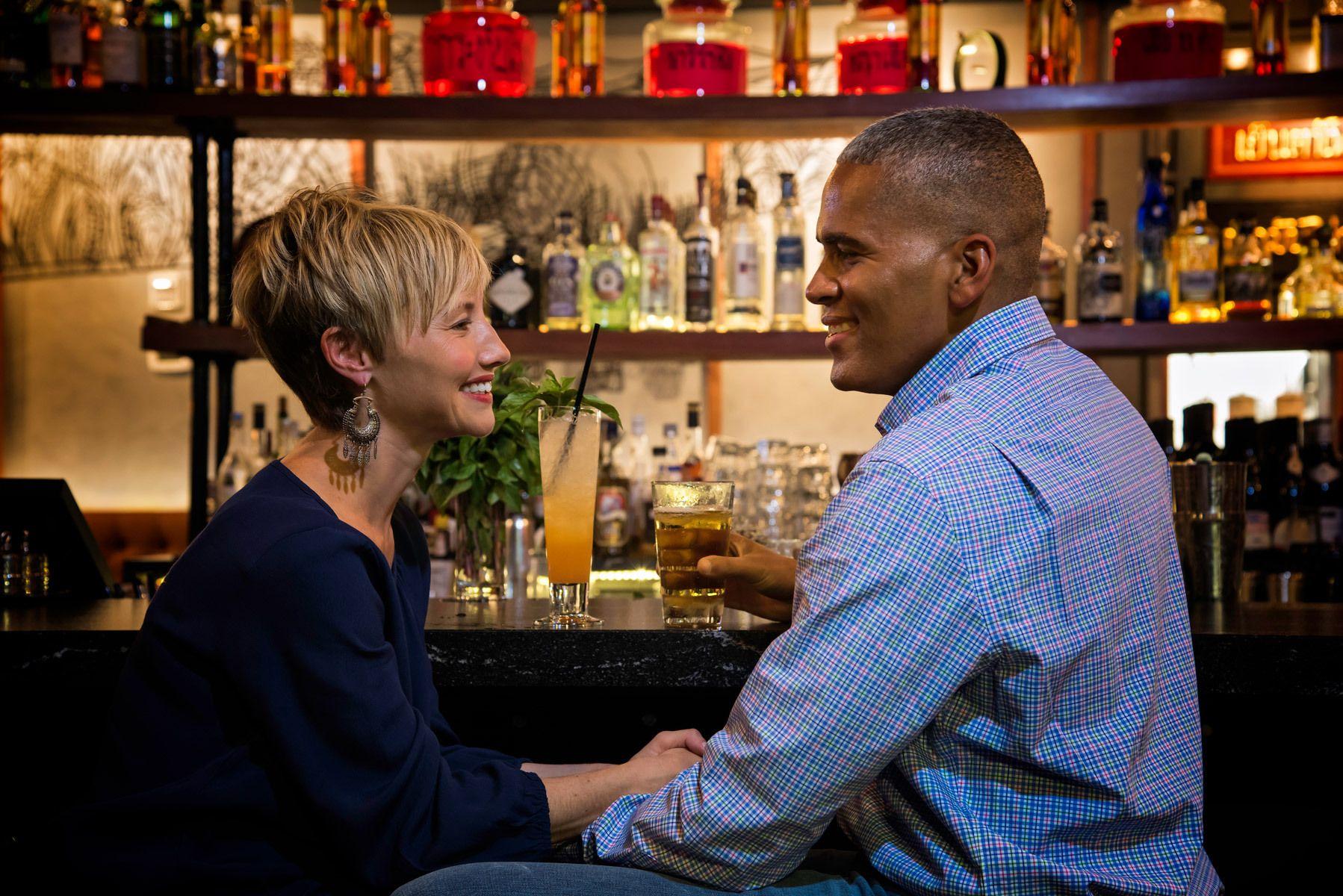 Bi-racial couple at a bar